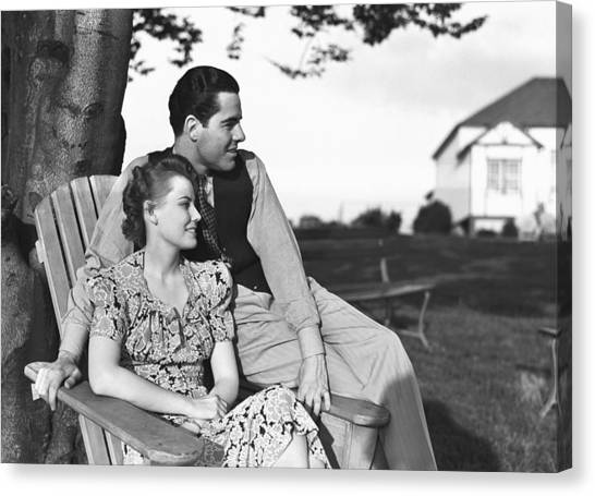 Couple Relaxing On Deckchair In Garden, (b&w) Canvas Print by George Marks