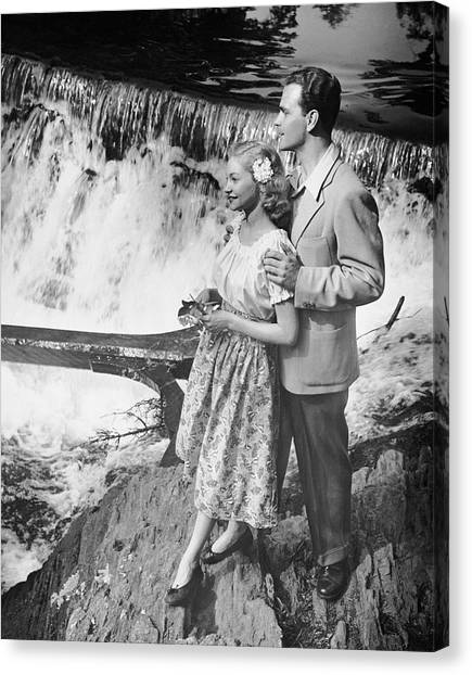 Couple Standing Near Waterfall Canvas Print by George Marks