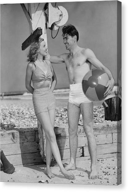 Couple Standing On Beach, Talking, (b&w) Canvas Print by George Marks
