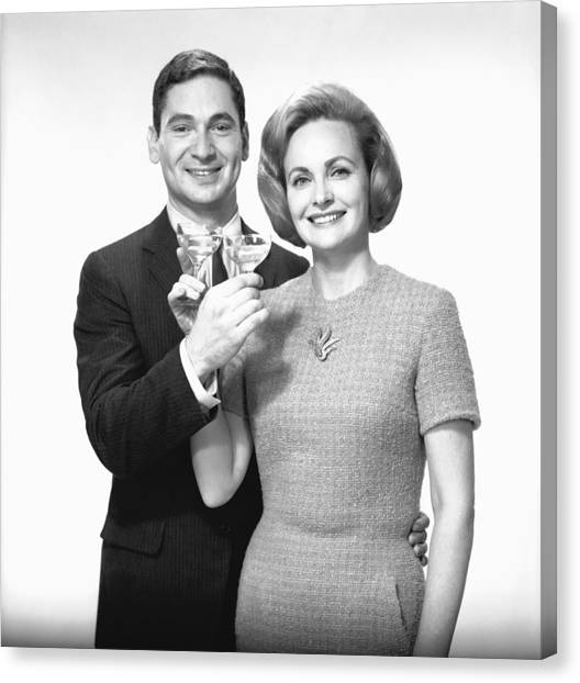 Couple Toasting Champagne In Studio, (b&w),, Portrait Canvas Print by George Marks