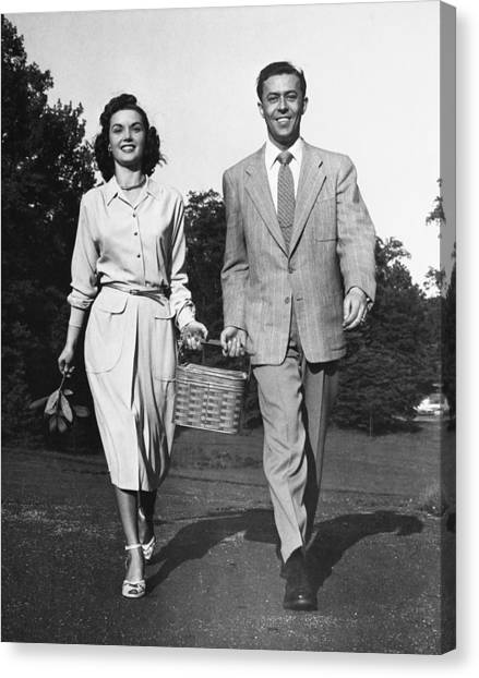Couple W/ Picnic Basket Canvas Print by George Marks