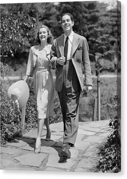 Couple Walking Together Outdoors Canvas Print by George Marks