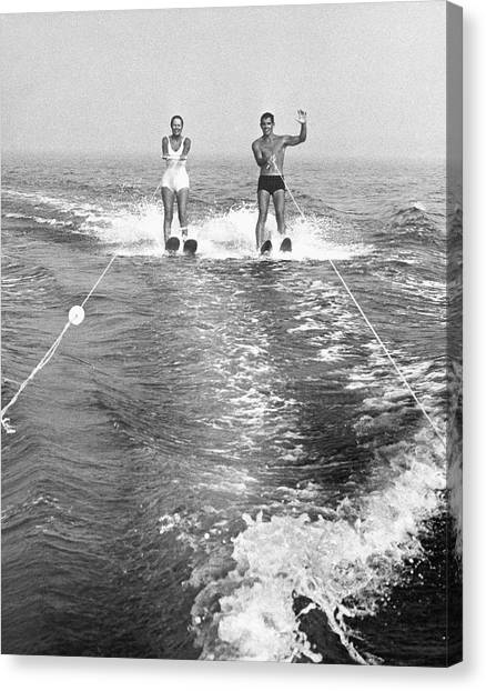 Couple Water Skiing Canvas Print by George Marks