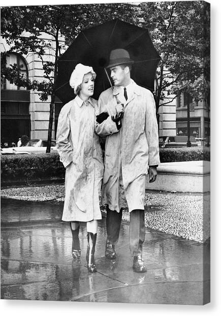 Couple W/umbrella Walking In The Rain Canvas Print by George Marks