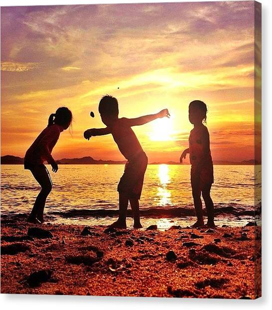 Ocean Sunsets Canvas Print - Cousins Throwing Rocks In The Ocean At by Brad Kremer