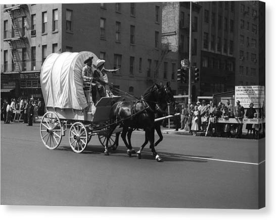 Covered Wagon On Street During Parade Canvas Print by George Marks