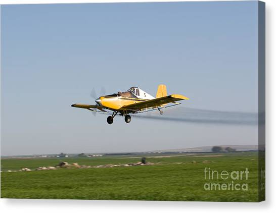 Crop Duster Flying Over Farm  Canvas Print