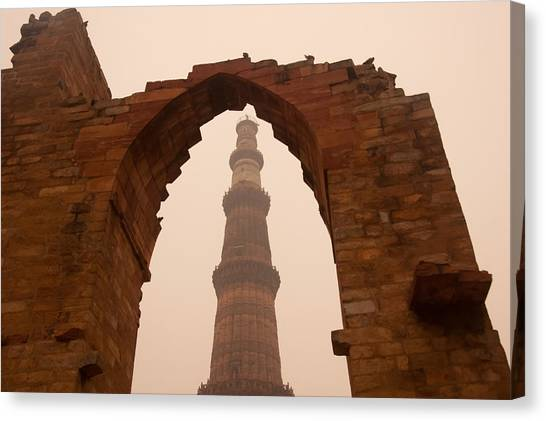 Cross Section Of The Qutub Minar Framed Within An Archway In Foggy Weather Canvas Print