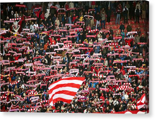 Crowd Of Fans Raise Scarves In Support Of Red Star, One Of Sebia's Premier Soccer Teams Canvas Print by Greg Elms