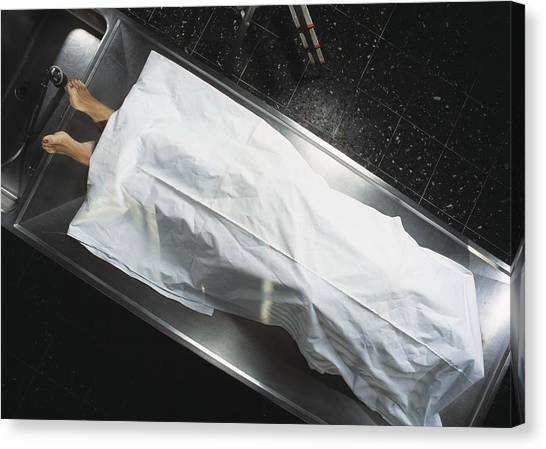 Dead Body In A Mortuary Canvas Print by Volker Steger