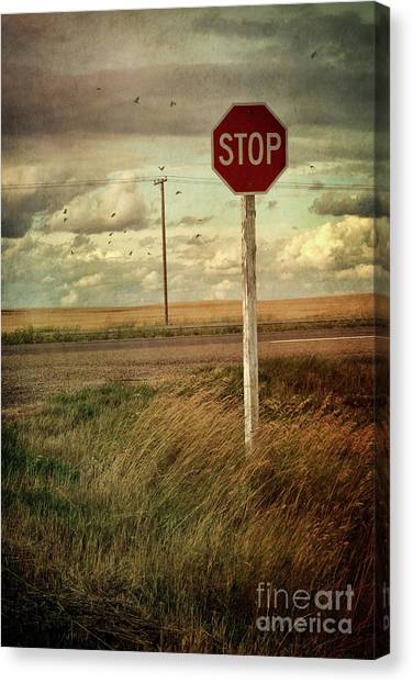 Stop Sign Canvas Print - Deserted Red Stop Sign On The Prairies by Sandra Cunningham
