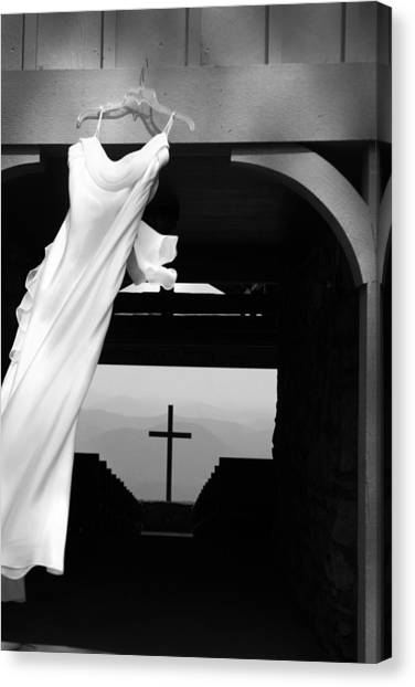 Canvas Print featuring the photograph Dress And Cross by Kelly Hazel