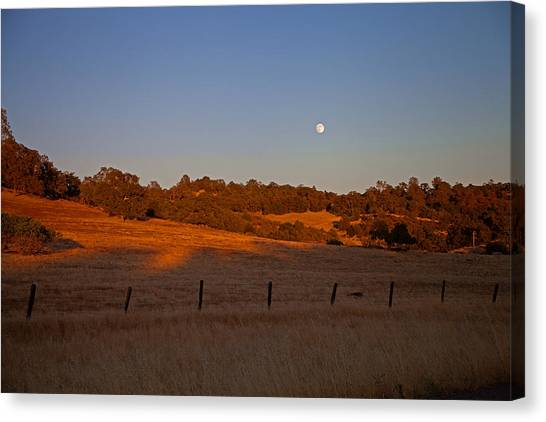 Early Moon Over Campo Seco Canvas Print by Joe Fernandez