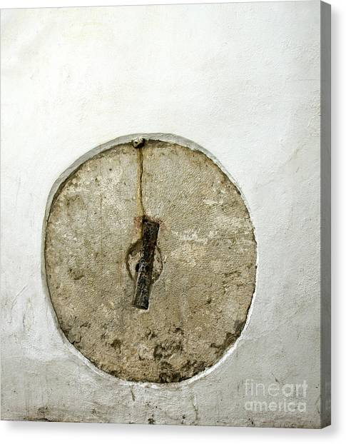 Embedded Millstone In A Street Of Seville  Canvas Print by Perry Van Munster