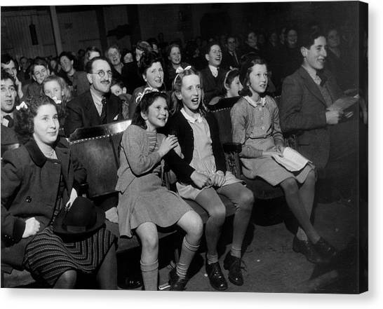 Enthralled Audience Canvas Print by Kurt Hutton