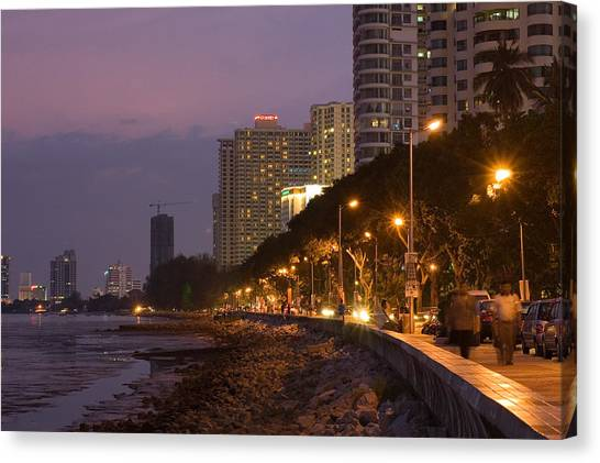 Evening Falls Over Water Front Buildings Canvas Print by Austin Bush