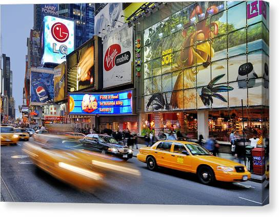 Evening Traffic At Times Square Canvas Print by Izzet Keribar