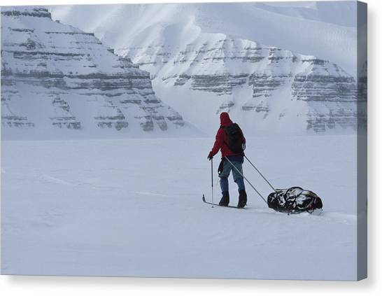 Sleds Canvas Print - Expedition Skier Drags Sled by Gordon Wiltsie