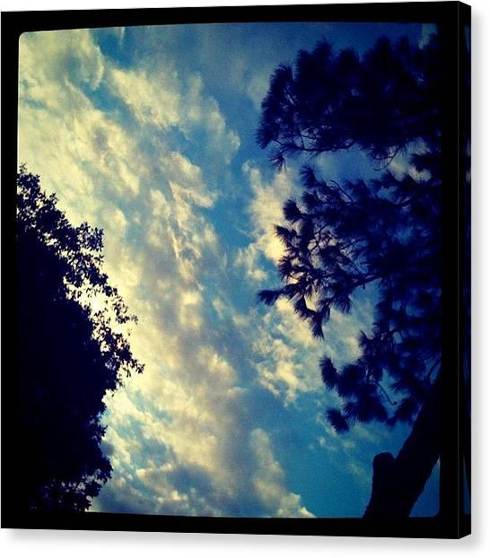 Surrealism Canvas Print - Fake? #clouds #cloudporn #sky #light by Emily W