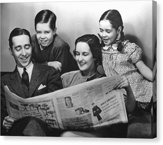 Family Reading Newspaper Canvas Print by George Marks