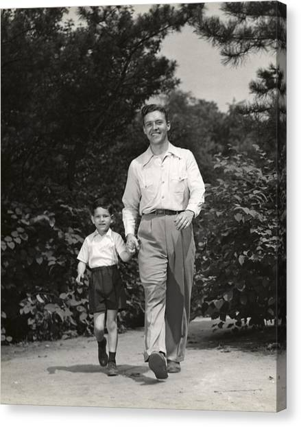 Father Walking With Son Canvas Print by George Marks