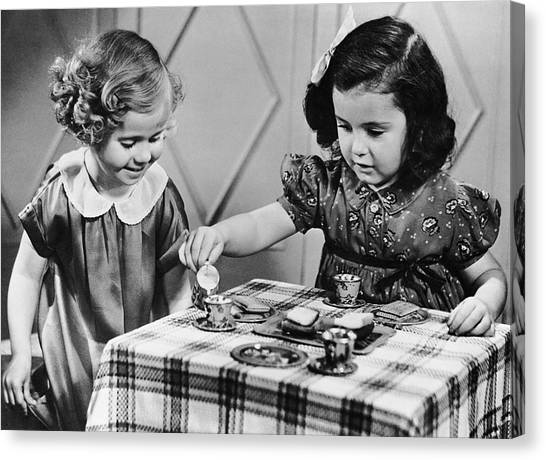 Female Siblings Having A Tea Party Canvas Print by George Marks