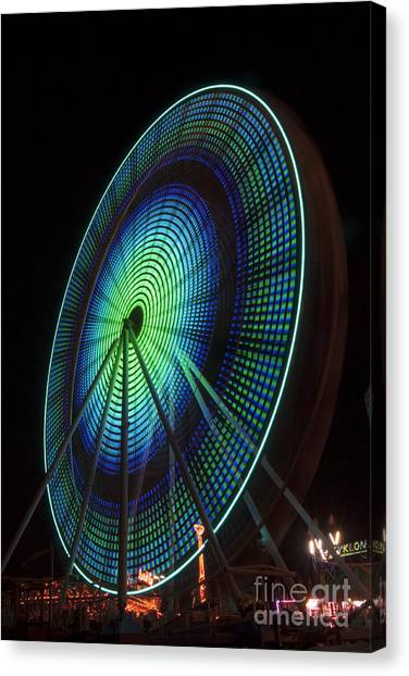 Ferris Wheel Lit Shades Of Green And Blue Canvas Print