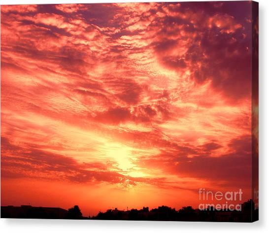 Fiery Sunrise Canvas Print by Graham Taylor