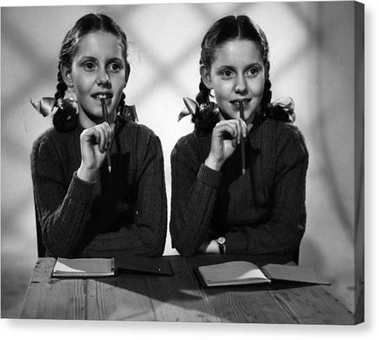 Film Star Twins Canvas Print by Maurice Ambler