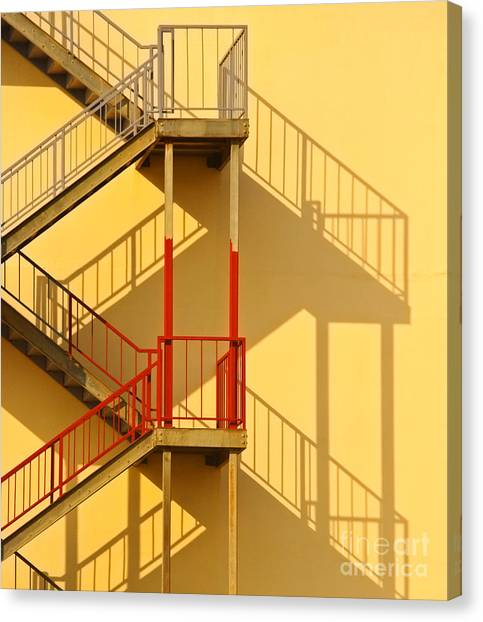 Fire Escape And Shadow Canvas Print by David Buffington