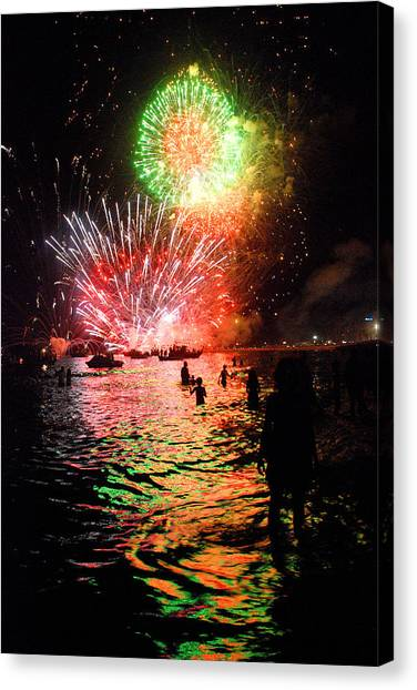 Fireworks On The Beach Canvas Print by Perry Van Munster