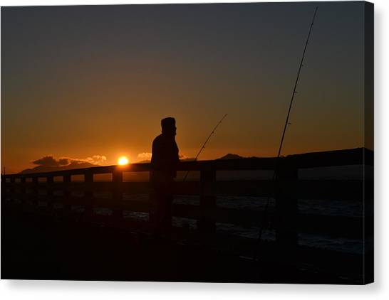 Fishing And Sunset  Canvas Print by Saifon Anaya