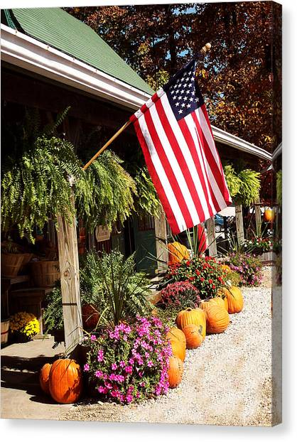 Flag Among The Pumpkins Canvas Print by Judith Lawhon