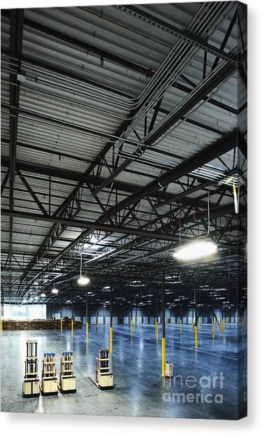 Forklifts Canvas Print - Forklifts In An Empty Warehouse by Jetta Productions, Inc