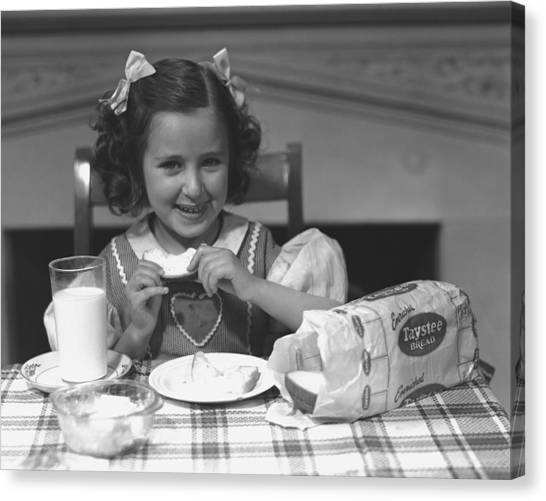 Girl (4-5) Eating Breakfast, (b&w) Canvas Print by George Marks