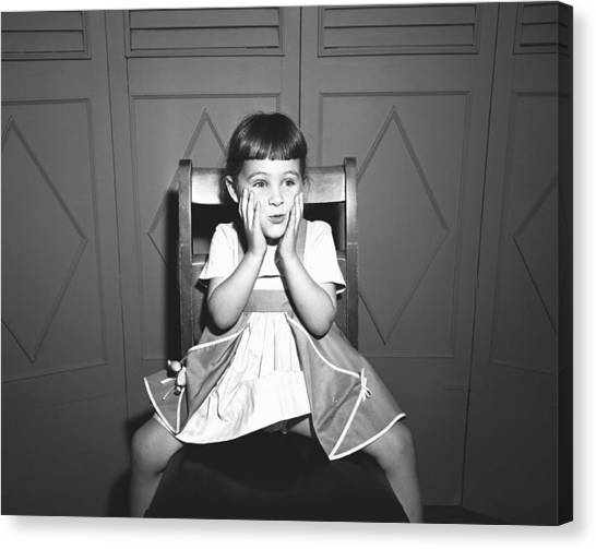 Girl (5-5) Sitting Astride Chair, Making Face, (b&w), Canvas Print by George Marks