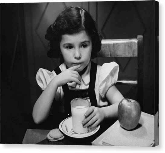 Girl (6-7) Sitting At Table, Having Breakfast, (b&w) Canvas Print by George Marks