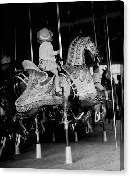 Girl Riding A Carousel Canvas Print by George Marks