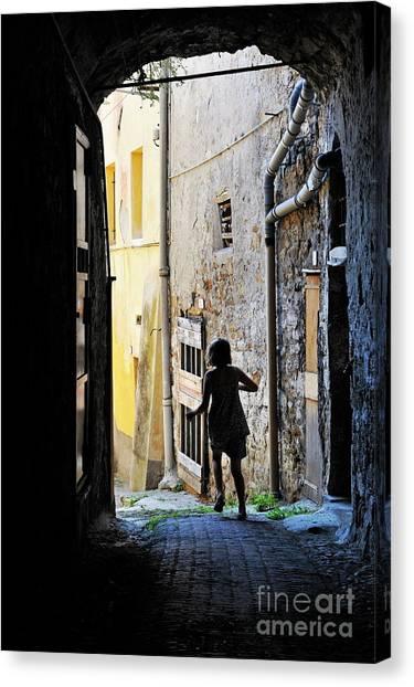 Girl Running Through A Cobblestone Street Canvas Print by Sami Sarkis
