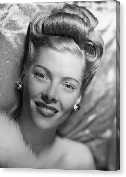 Glamorous Woman Lying On Satin Pillow, (b&w), Portrait Canvas Print by George Marks