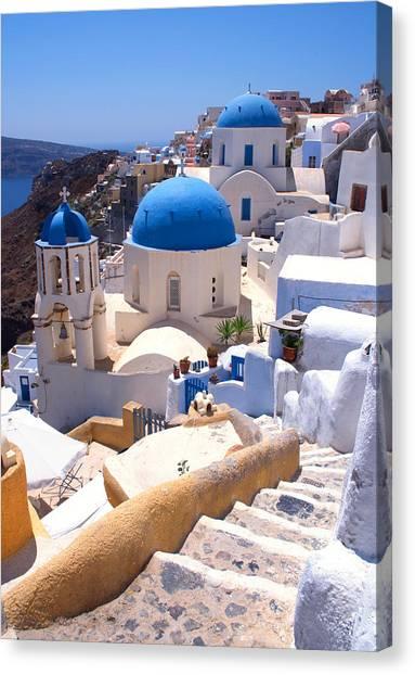 Greek Churches And Steps Canvas Print by Paul Cowan