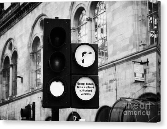 Turn Signals Canvas Print - Green Traffic Light Signal With No Right Turn Except Buses Taxis Cycles And Authorised Vehicles Glas by Joe Fox