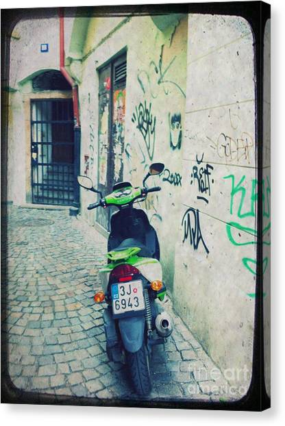 Street Canvas Print - Green Vespa In Prague by Linda Woods