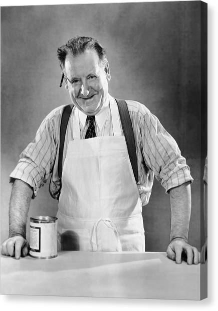 Grocery Store Salesman W/can On Counter Canvas Print by George Marks
