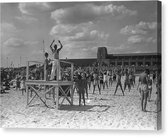 Group Of People Exercising On Beach, (b&w) Canvas Print by George Marks