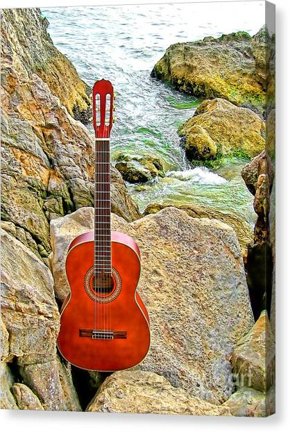 Guitar By The Sea Canvas Print