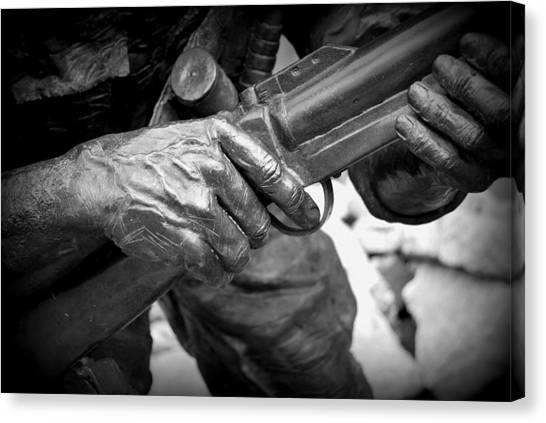 Hands Of War Canvas Print