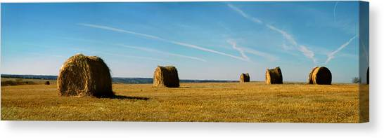 Haybales And Jet Trails Canvas Print