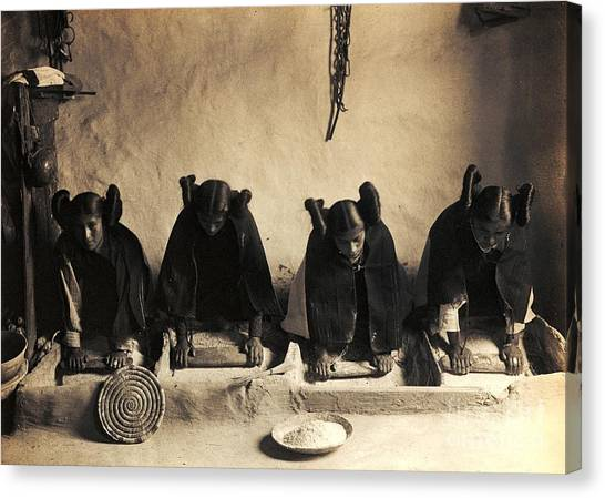 Hopi Girls Grinding Corn Canvas Print by Pg Reproductions