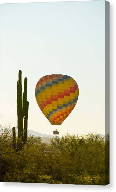 Hot Air Balloon In The Arizona Desert With Giant Saguaro Cactus Canvas Print